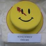 watchmen comedian button cake