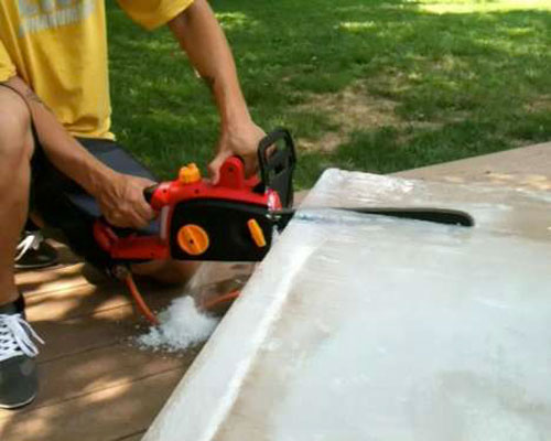 Cutting Ice with Chainsaw