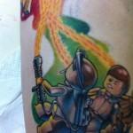 ghostbusters lego tattoo leg
