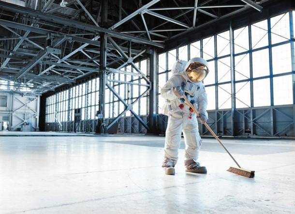 Astronaut sweeping a hangar