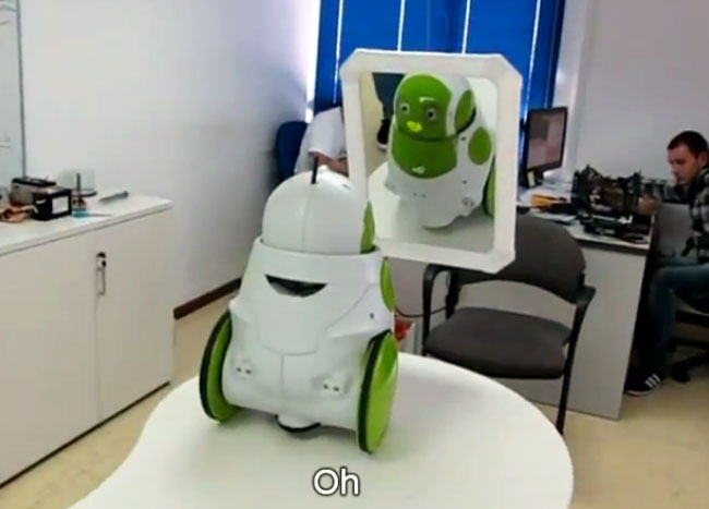 Qbo robot recognizing itself in a mirror.