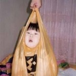 baby in a plastic bag FUNNY PHOTO