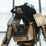 """Japanese artist Kogoro Kurata, inventor of the giant """"Kuratas"""" robot, climbs out of its cockpit at an exhibition in Tokyo"""