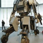 """A man looks at a giant """"Kuratas"""" robot at an exhibition in Tokyo"""