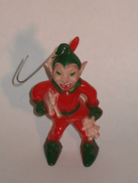 Scary Little Boy - 13 Extremely Creepy Christmas Decorations - Walyou