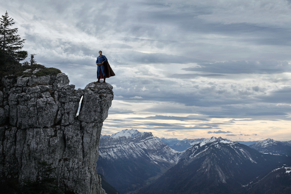 Superman up on a cliff