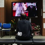 An evacuee of the earthquake and tsunami watches a TV broadcast of the wedding of Britain's Prince William and Kate Middleton in Chofu, western Tokyo
