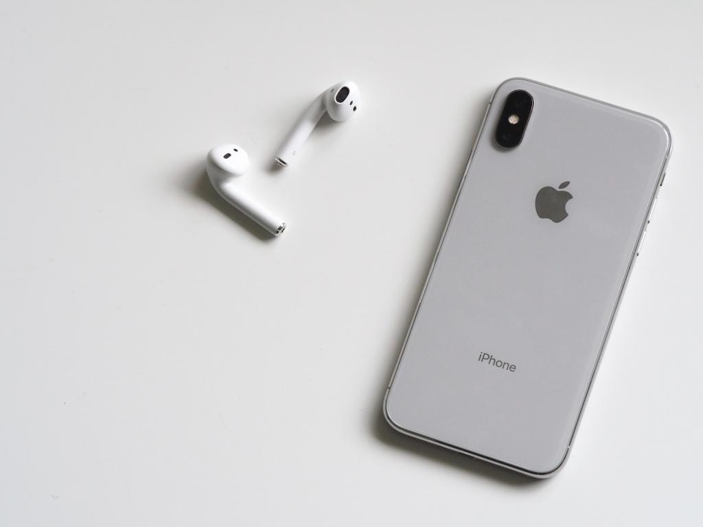 a silver iphone by apple