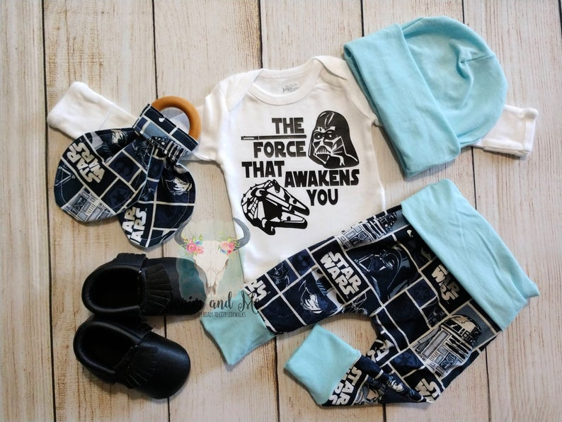 Storm Pooper and the dark side on the back. Babysuit in Navy blue Starwars